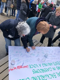Susan Schultz and Joan Leuthner from Ligonier, Pa. sign a pledge of support at the March for Our Lives rally in Greensburg on March 23.