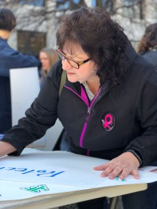 Nancy Dunn from Jeannette, Pa. makes a sign at the March for Our Lives rally in Greensburg on March 23.