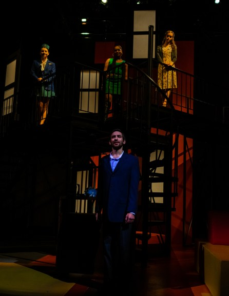 """Robert (Noah Telford) stands in front of his three love interests: April (Nicole Castelli, left), Marta (Azaria Oglesby, middle) and Kathy (Hannah Taylor, right) during Seton Hill University's production of """"Company"""" from Oct. 19-27."""