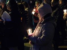 A young member of the community holds her candle during the candlelight vigil at the Westmoreland County Courthouse in Greensburg on Oct. 29 for the victims of the shooting at the Tree of Life synagogue in Squirrel Hill.