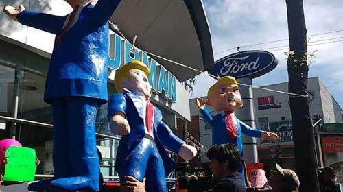 Protestan contra Trump en agencia de autos de la CDMX