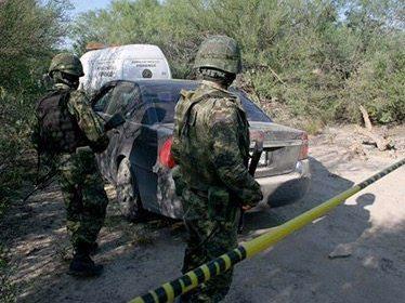 Identifican restos de 56 personas halladas en fosa clandestina en NL