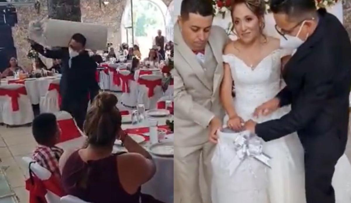 #VIDEO Padrino les regala a los novios tanque de gas y se vuelve viral