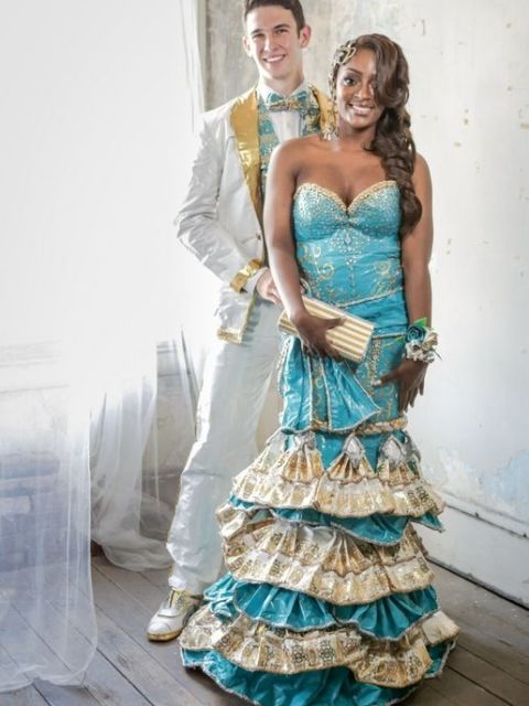 Ronnita and her date's ensemble required over 90 rolls of duct tape and 400 hours to complete. Even her accessories — including her corsage, earrings, clutch, headpiece, and nail art — are made from tape! She took second place in Duck Tape's 2014 contest.