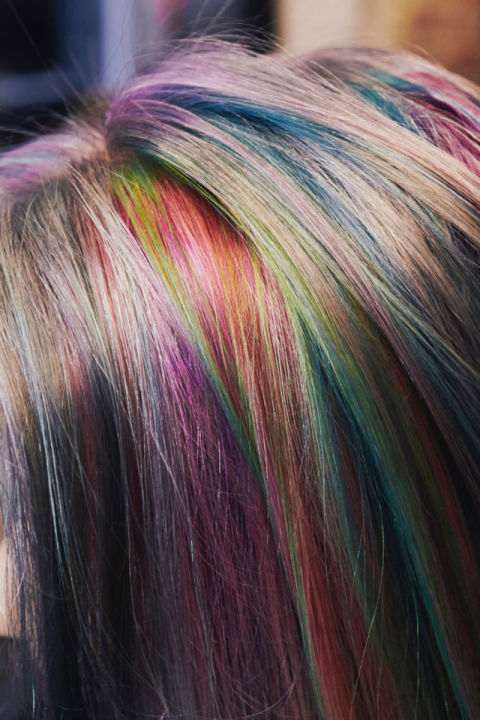 Payne used approximately 12 different shades to achieve this dramatic effect. The best part? Depending on where I part my hair, a completely new range of colors reveals itself.