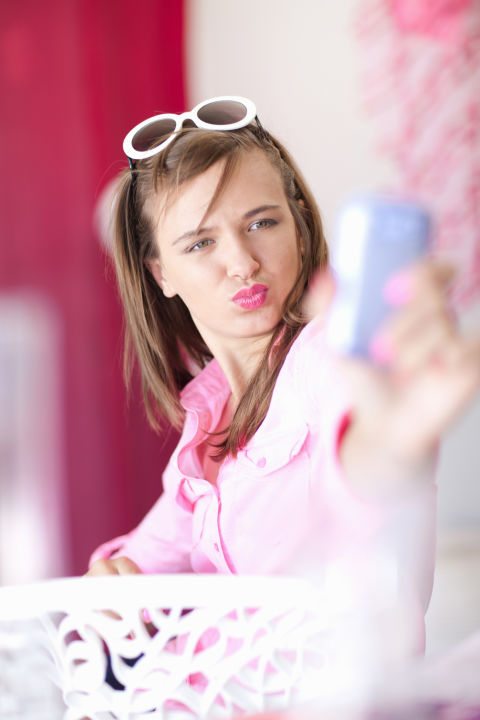 Wearing a bright lipstick will give your pic a cool focal point and will take your kissy face selfie to the next level.