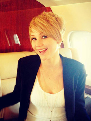 "After filming Catching Fire, J. Law debuted this amazing punk-y pixie during a Google+ Hangout with the cast! She explained her new 'do, saying, ""I just did it to make [Director] Francis [Lawrence] mad. I did it just to annoy him. He totally thought it was me giving him the finger. But it's not. It's just fried from being dyed so much."" Whatever the reason, we love the look!"