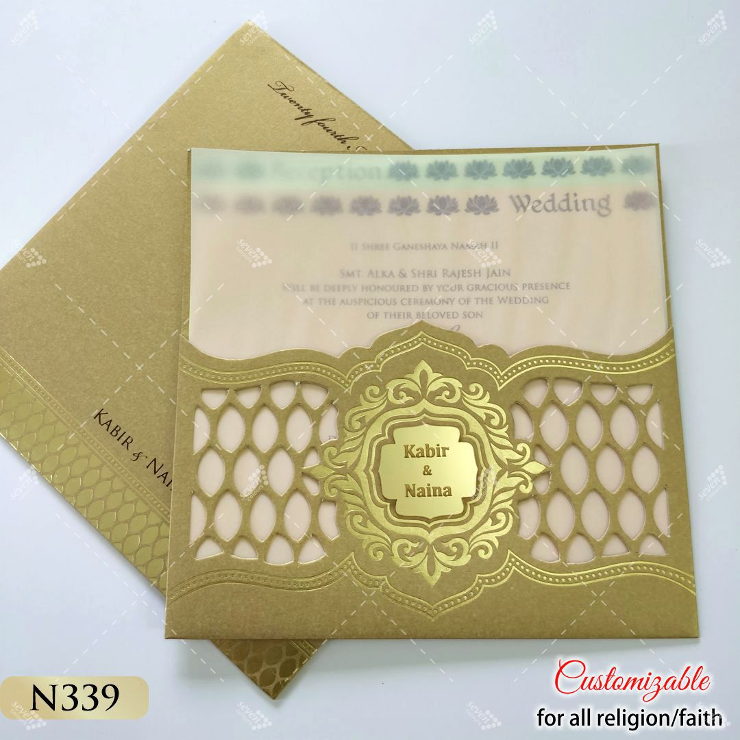 gold laser cut invitation with pastel colour inserts