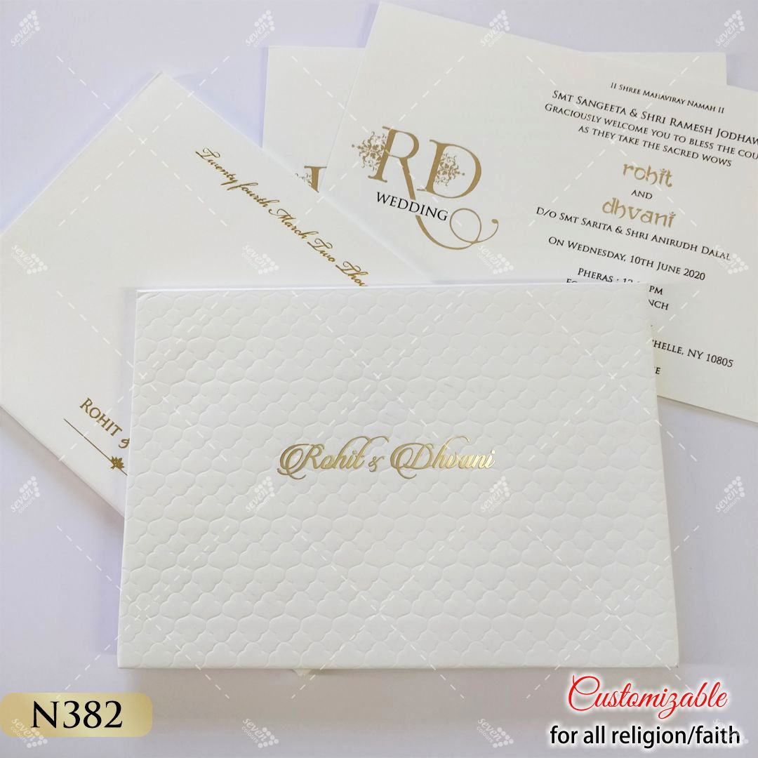 punjabi premium quality wedding card in white emossed design and real gold bride and groom names