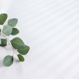 fitted sheet with decorative foliage