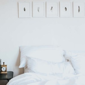 beautifully made bed with sevenfold linens