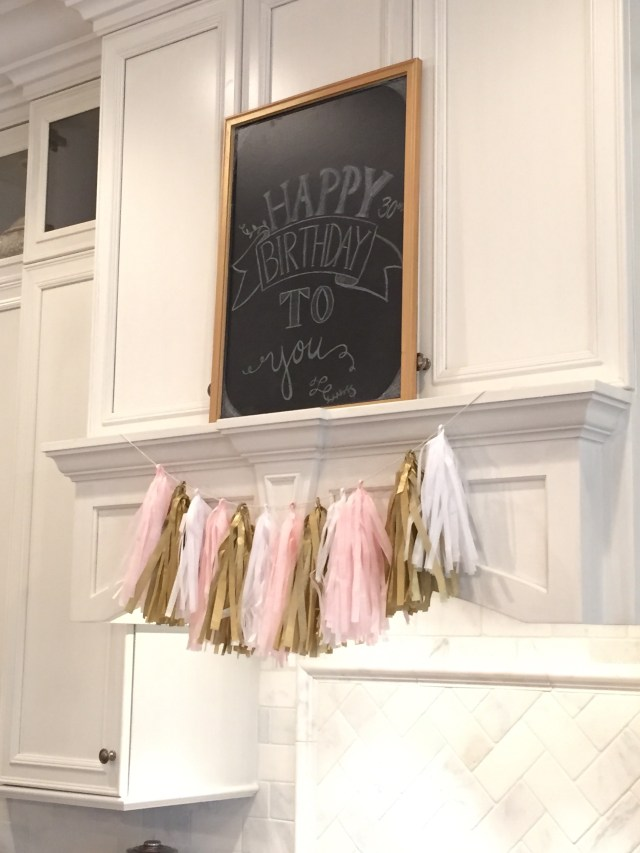 pink, gold and white tassel; happy birthday sign
