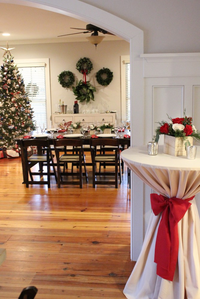 Christmas wall decor with wreaths; Christmas dinner party at home; rustic Christmas decor