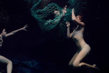christine ren underwater dance two individuals caught in a ghost net