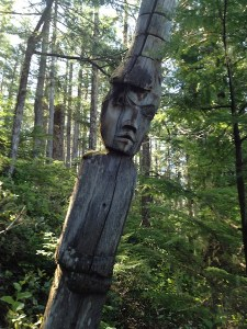 totem pole in the forrest along the coast of the great bear sea