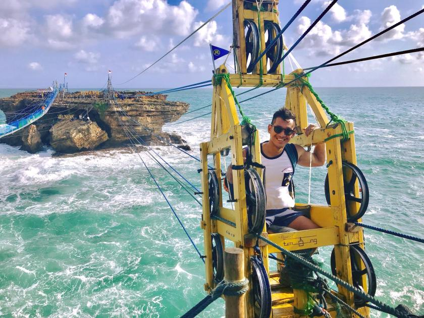Em Surasak travel blogger for sevenseas media on a wire bridge