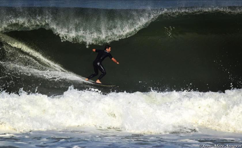 Cedric Giscos and Lionel Franssen from Shores of Fear surfing a wave in the ocean