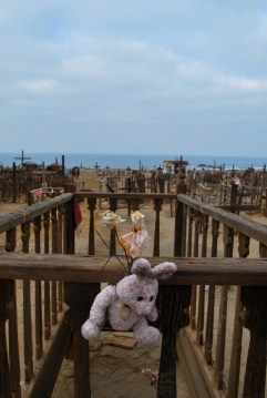 Toys and sweets adorn Victorian-style cribs at this beach baby cemetery on the coast.