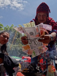 Andean priest blesses money