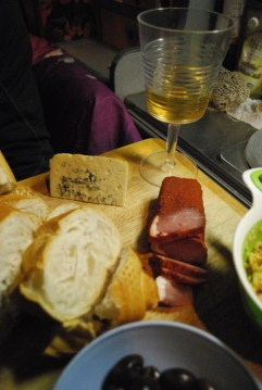 Cured llama ham, blue cheese, olives, bread and chick pea hummus and a glass of Torrontes.