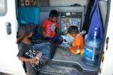 Kids playing in the van, Colombia.