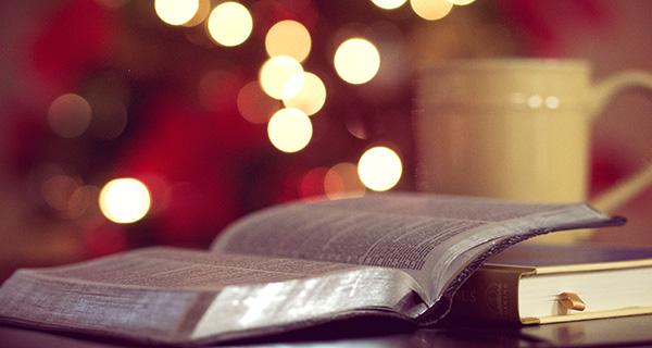 Bible, mug, and Christmas lights