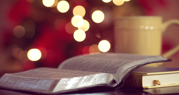 Bible, mug, and Christmas lights
