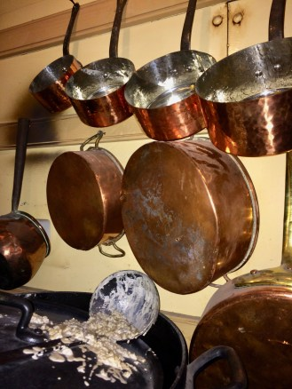 Copper pots and porridge in the kitchen. SS Great Britain