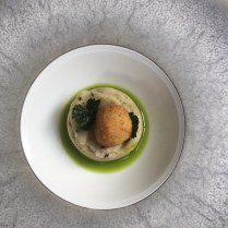 Crispy quail's egg with truffle mash and parsley oil