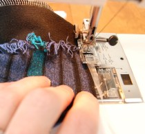 Sew your elastic to the upper edge while gently stretching