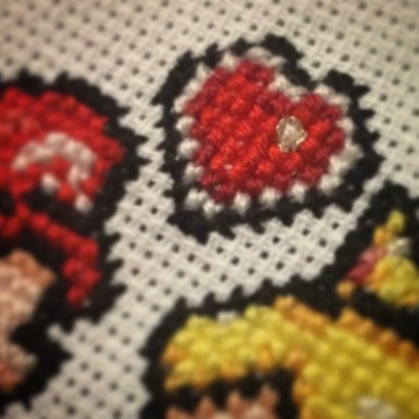 Detail of the wedding sampler that included metallic thread for an extra touch of sparkle.