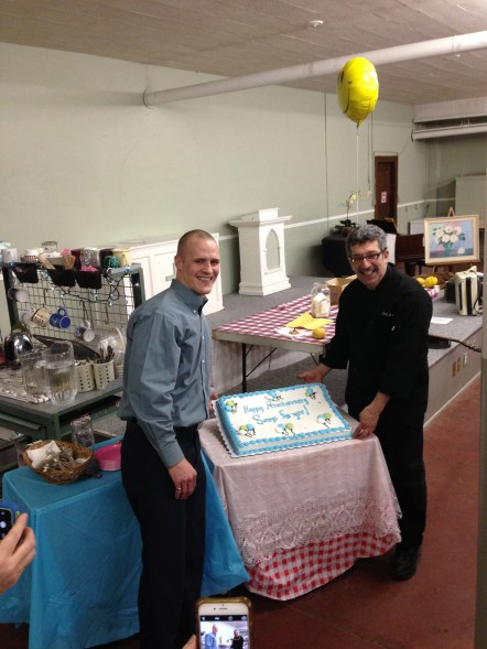 Pastor Mike and Judah with 1st Anniversary Cake pic by Jim Welna