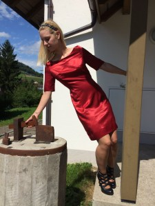 Silky red dress playing with hammer