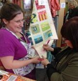 Tula signing A-B quilt