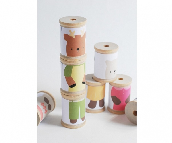 Use this free printable to turn your empty spools into cute mix and match toys