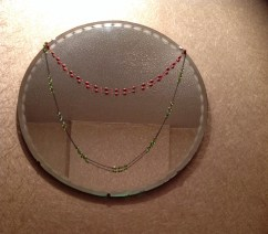 Victorian necklaces from a carboot hang over 1930's mirror that belonged to HH Nana