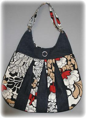 This purse is so stylish and it's a free sewing pattern too.  There are only written instructions but I'm confident I can do it!