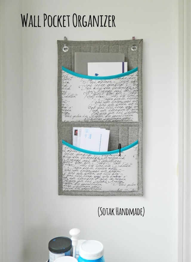 Learn how to sew this wall pocket organiser to keep all your stuff neat and tidy.  Free sewing pattern.
