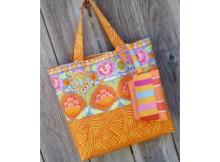 Why not show off those large personality prints in your stash with this straightforward tote. Simple lines mean the fabric does the hard work for you. A coordinating zip pouch with swivel hook and D ring completes the ensemble. Hang it from the outside or tuck it inside the tote. Either way, you can keep the necessities handy and look great doing it.