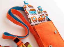 Here is a very cute and bright messenger bag that boys or girls will love. The PDF downloadable pattern and instructions for this bag/purse are both detailed and easy to follow and can be made by a beginner bag sewer.