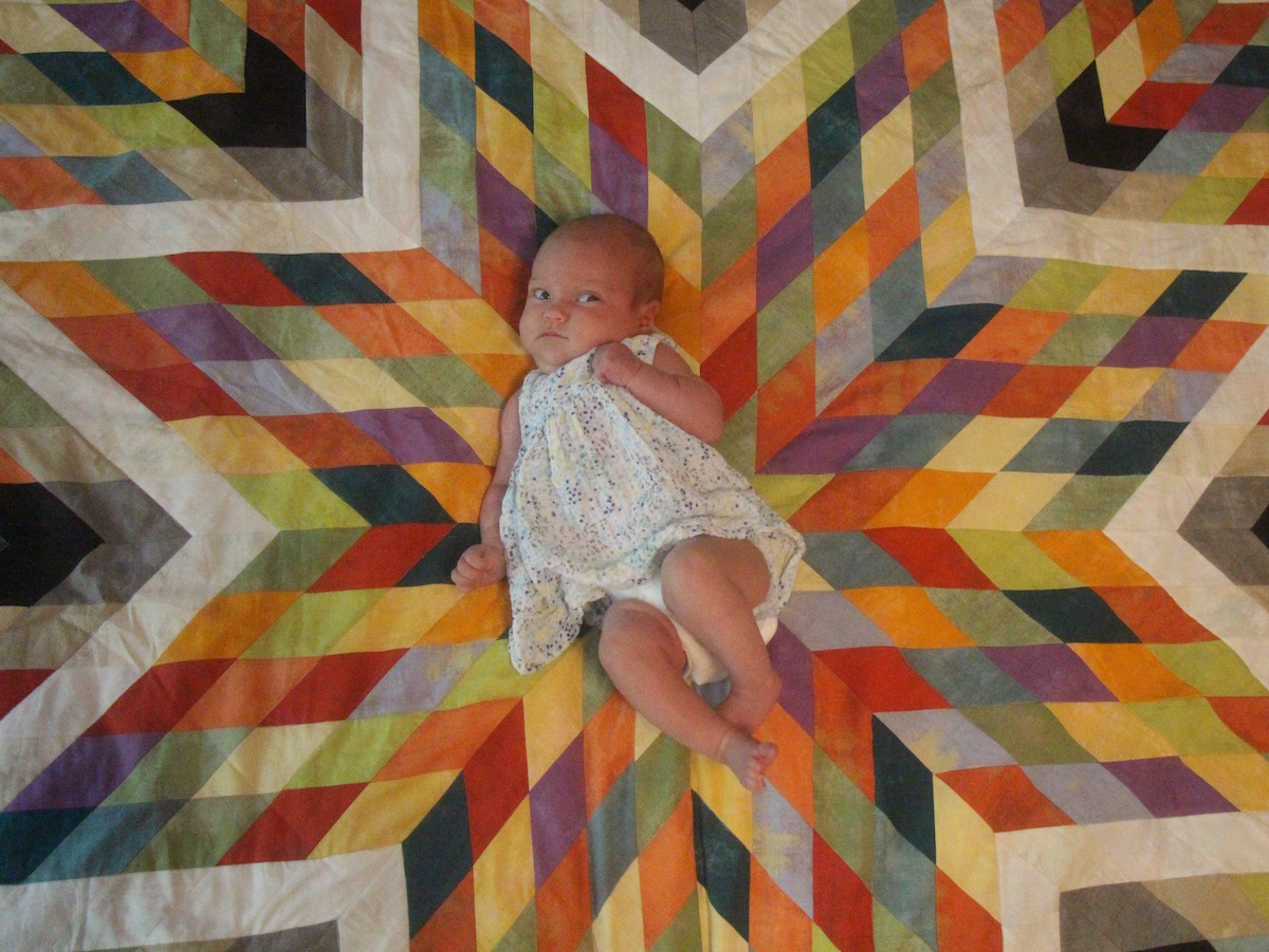 Miss Nova Pearl and the Supernova Starburst Quilt
