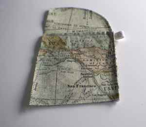 Add-the-Passport-pocket-to-the-ticket-pocket-and-sew-down-the-right-side.-300x260 Free DIY Passport Wallet Pattern