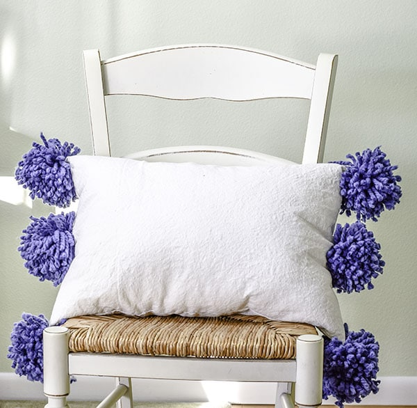 Make a drop cloth pom pom throw pillow
