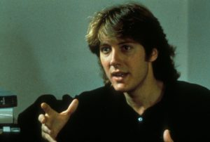 Image from sex, lies and videotape James Spader with a mullet, gesturing towards the camera
