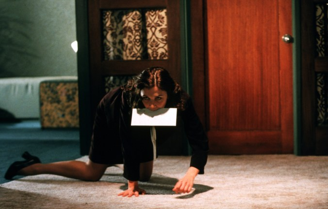 Lee crawling across the floor with a letter between her teeth