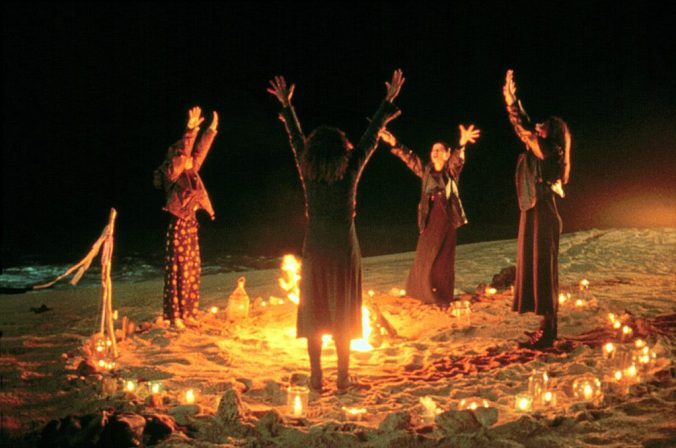 The witches from The Craft, in a circle around a fire