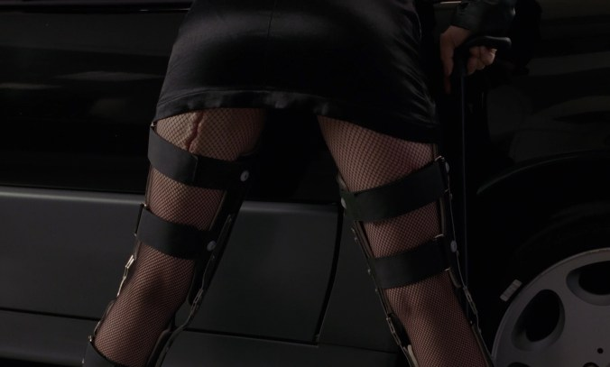 Arquette, bending over to reveal her fishnets, calipers and scar on the back of her thigh