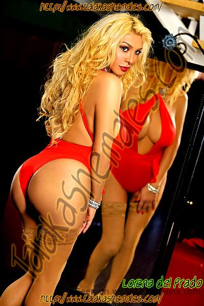 Stunning blonde transvestites from Netherlands in red beachwear.