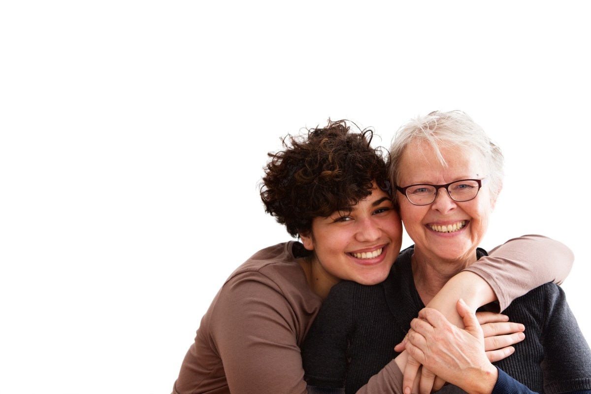 young woman embracing senior woman, both happy together, isolated on white