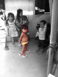 """This little group of kids followed us around and kept saying """" HAHA listen they speak Khmer but they should speak English...HA HA!"""" I also might point out the amazing pose miss yellow undies has! Sums up Cambodia I think!"""